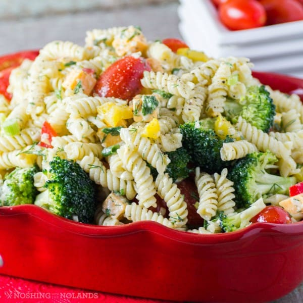 3 cheese pasta salad in a red serving dish