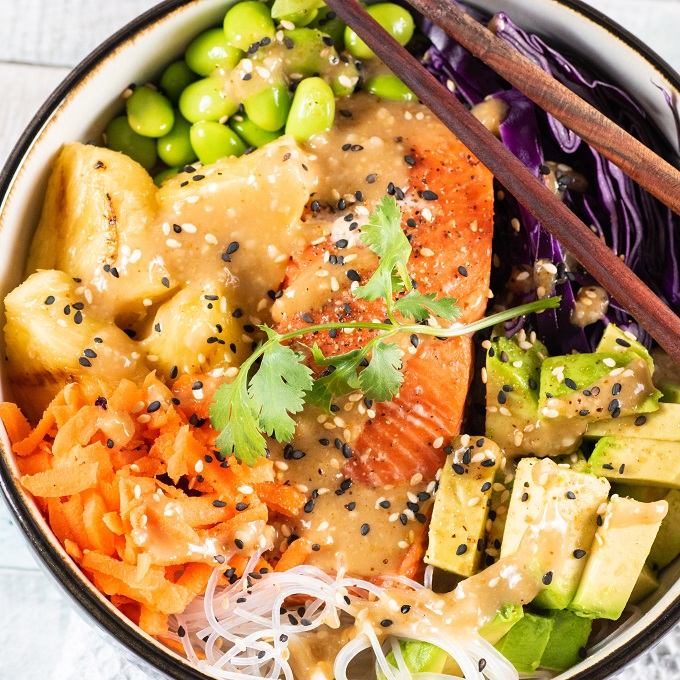 Vermicelli bowl with grilled salmon and pineapple, fresh veggies with chop sticks