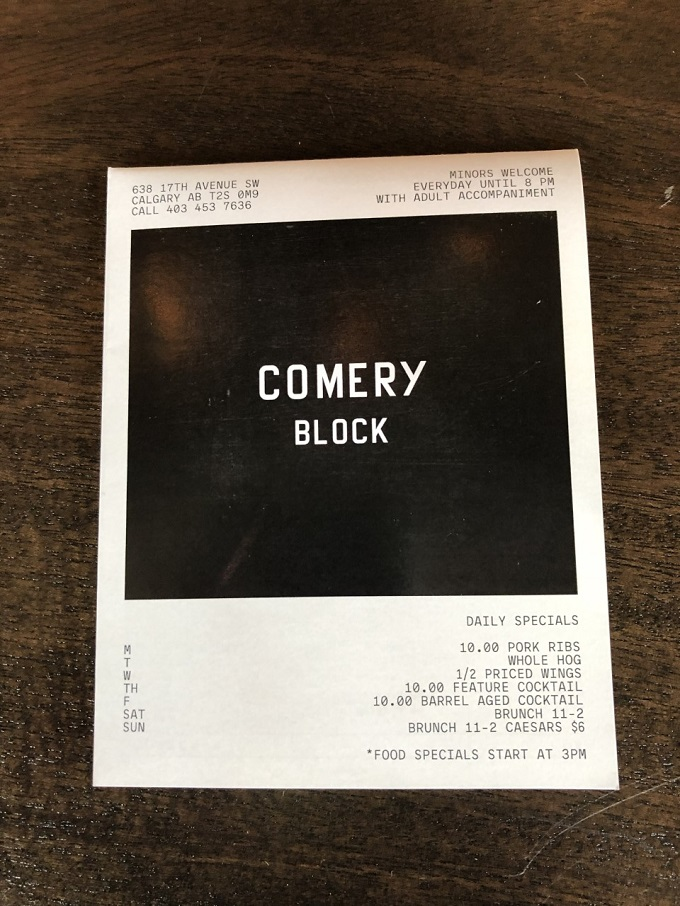 Comery Block menu on a wooden table