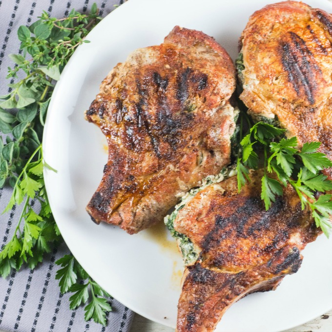 Grilled Stuffed Pork Chops cooked on a griddle or grill are so easy to make you're going to wonder why you don't make them all the time! #stuffedporkchops #porkchops #grilledporkchops #grilledstuffedporkchops
