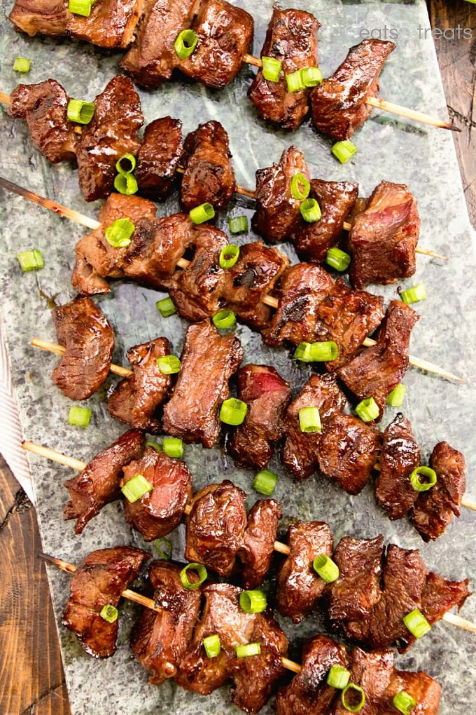 Steak kebabs on a granite serving platter