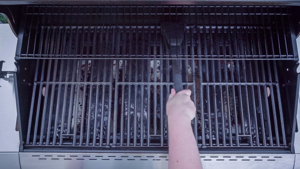 overhead view of a gas BBQ Grill being cleaned