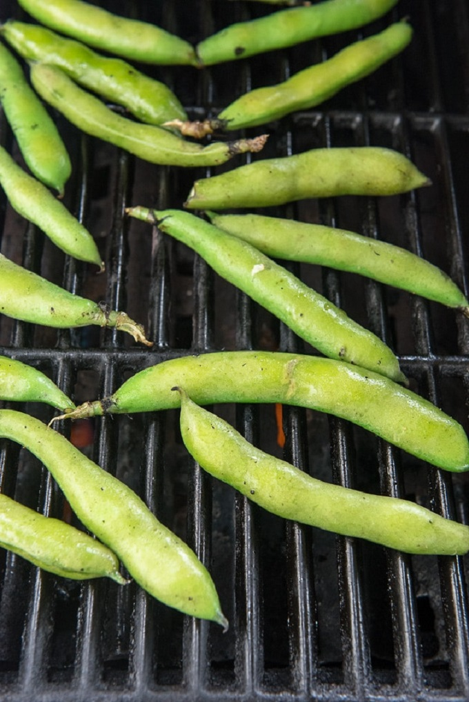 Whole fava beans roasting on the grill
