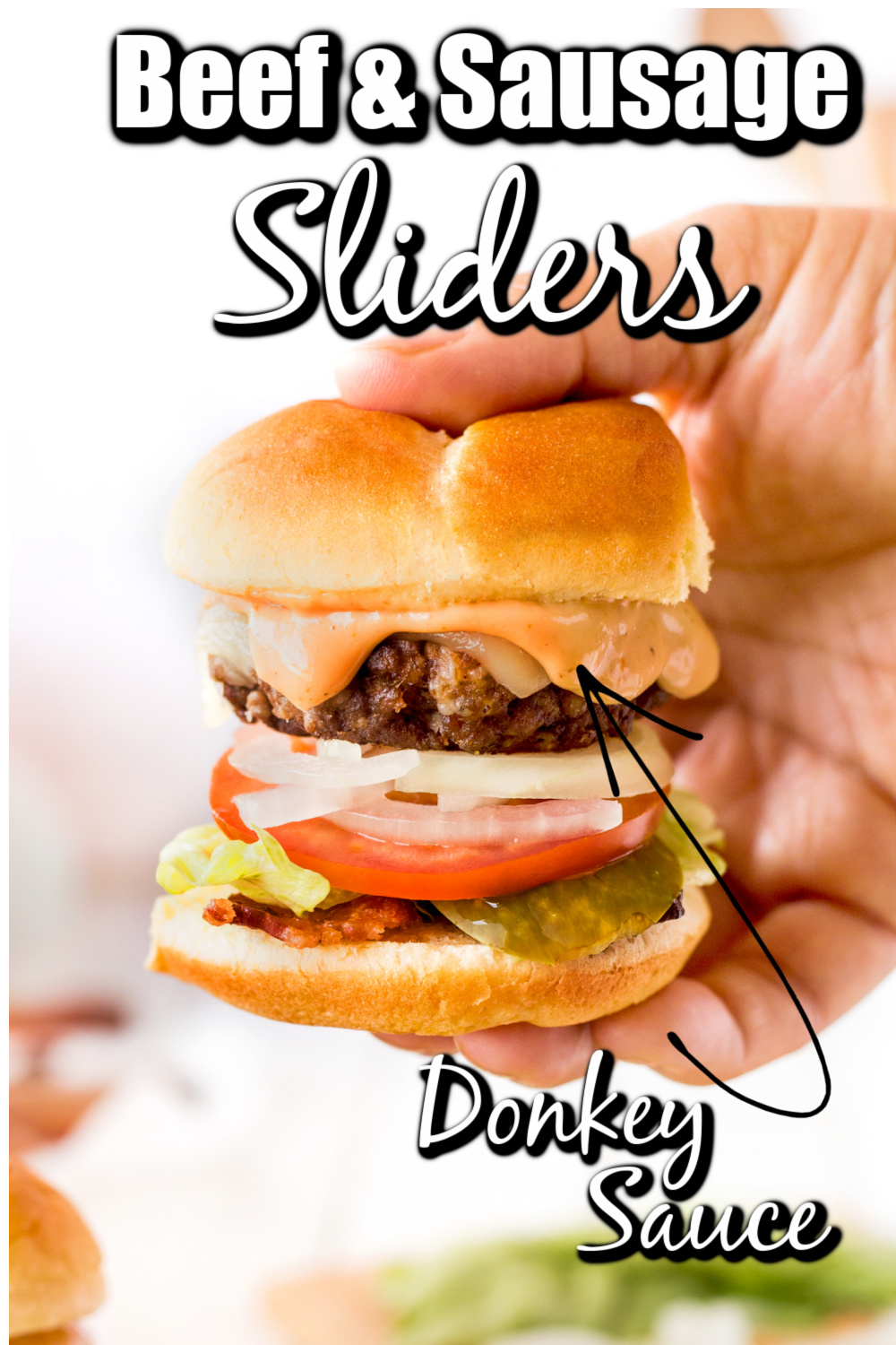 These Beef & Sausage Slider Burgers are perfect. They are quick, easy to make, and awesome with Donkey Sauce, the perfect sauce for a slider burger!