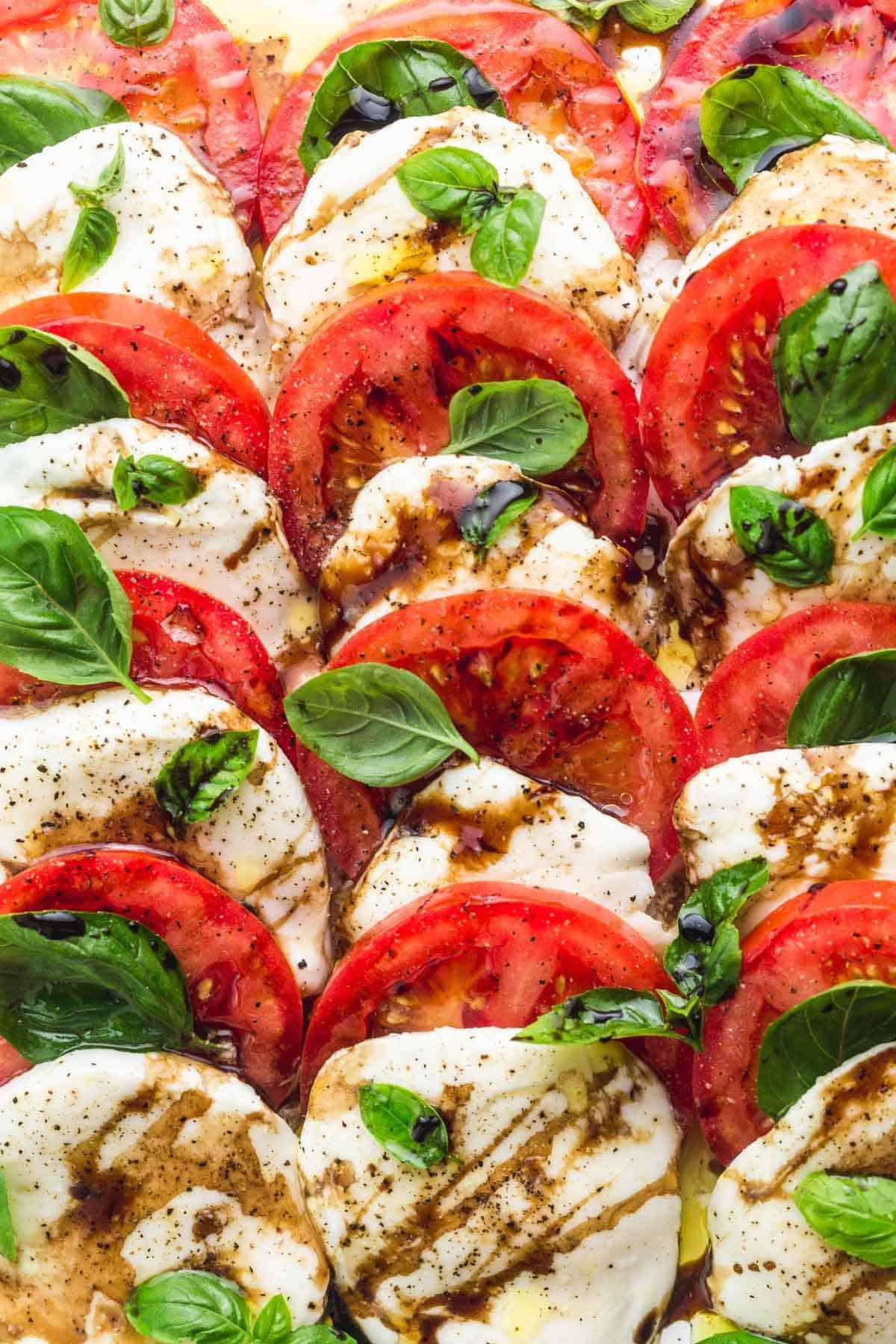 Caprese salad with balsamic glaze and basil leave