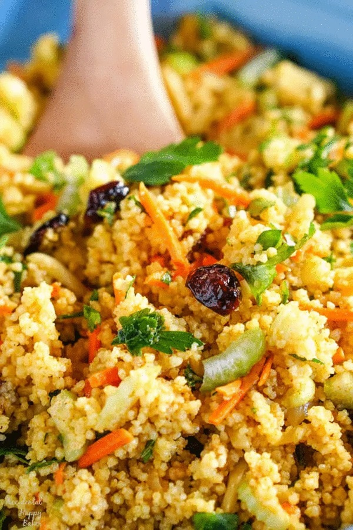 Curried couscous salad with dried cranberries and parsley