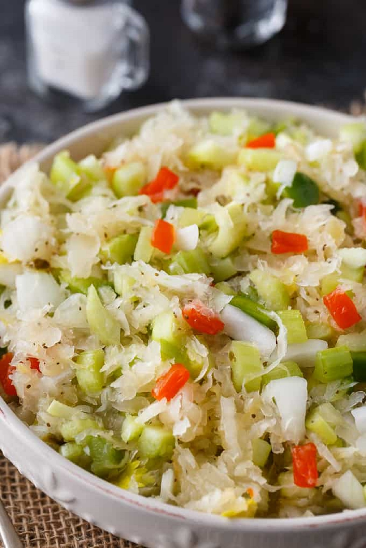 Sauerkraut salad in a white serving bowl