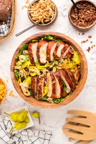 Grilled Chicken Salad in a large wooden bowl