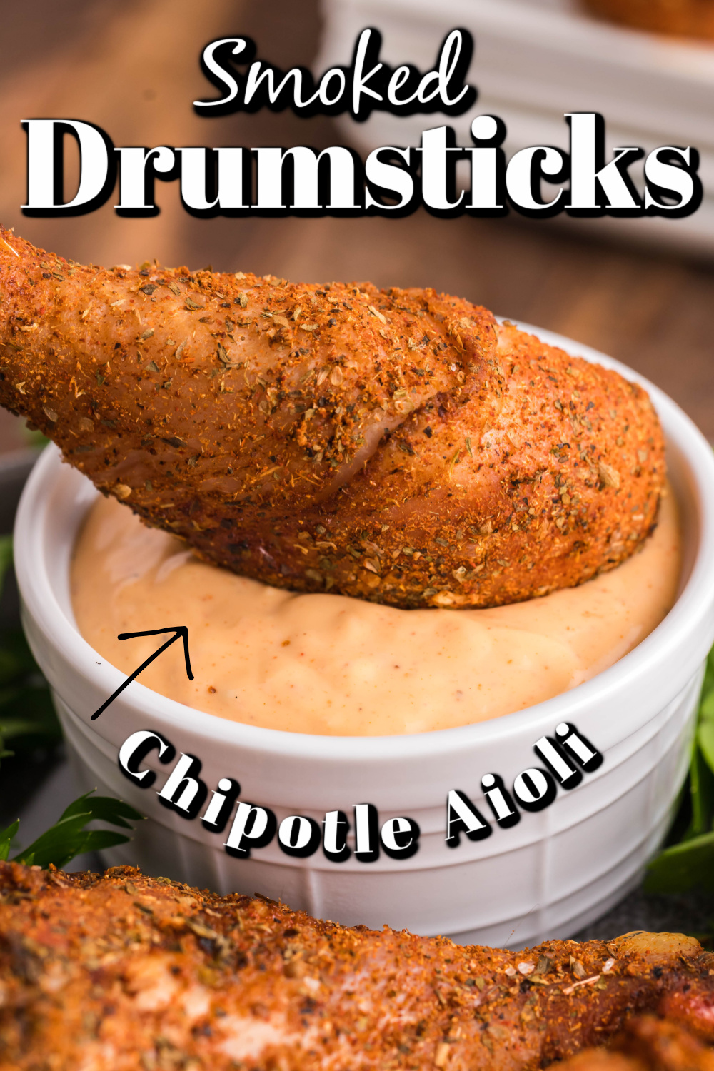 These dry rub smoked chicken drumsticks with a chipotle dipping sauce are wonderfully flavorful, tender and juicy!