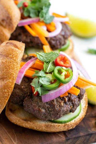 Banh Mi Burger on a toasted bun toped with quick pickled veggies