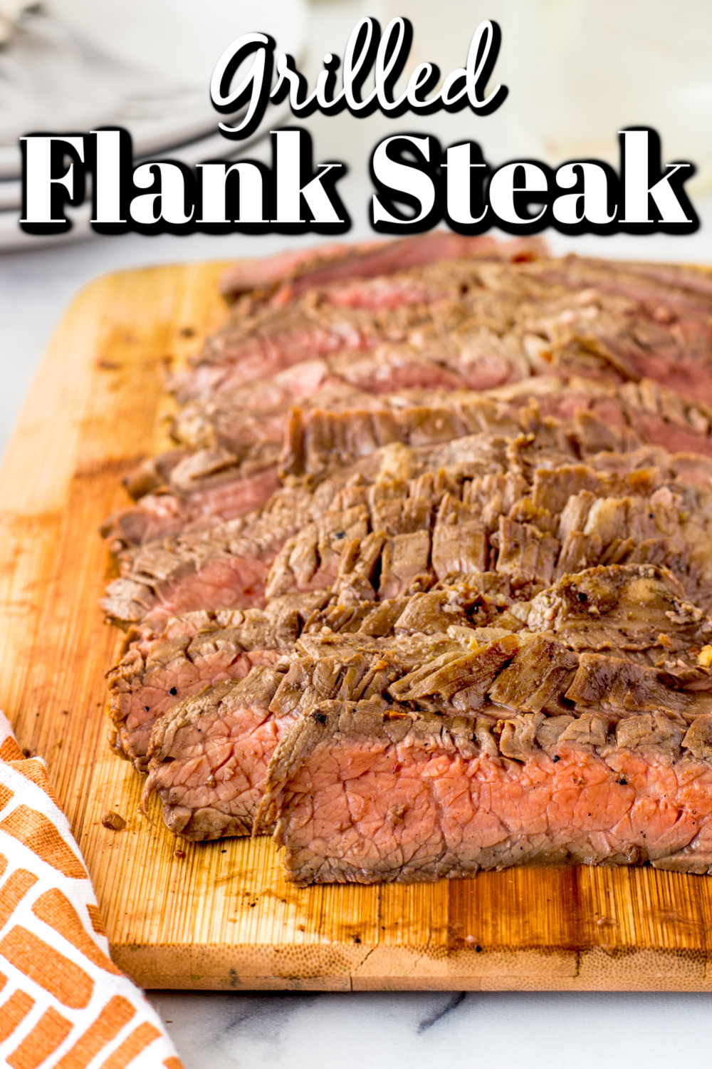 This Grilled Flank Steak done in a quick marinade and grilled over high heat simply melts in your month. It's perfect for a week night meal for the clan or a casual weekend dinner!