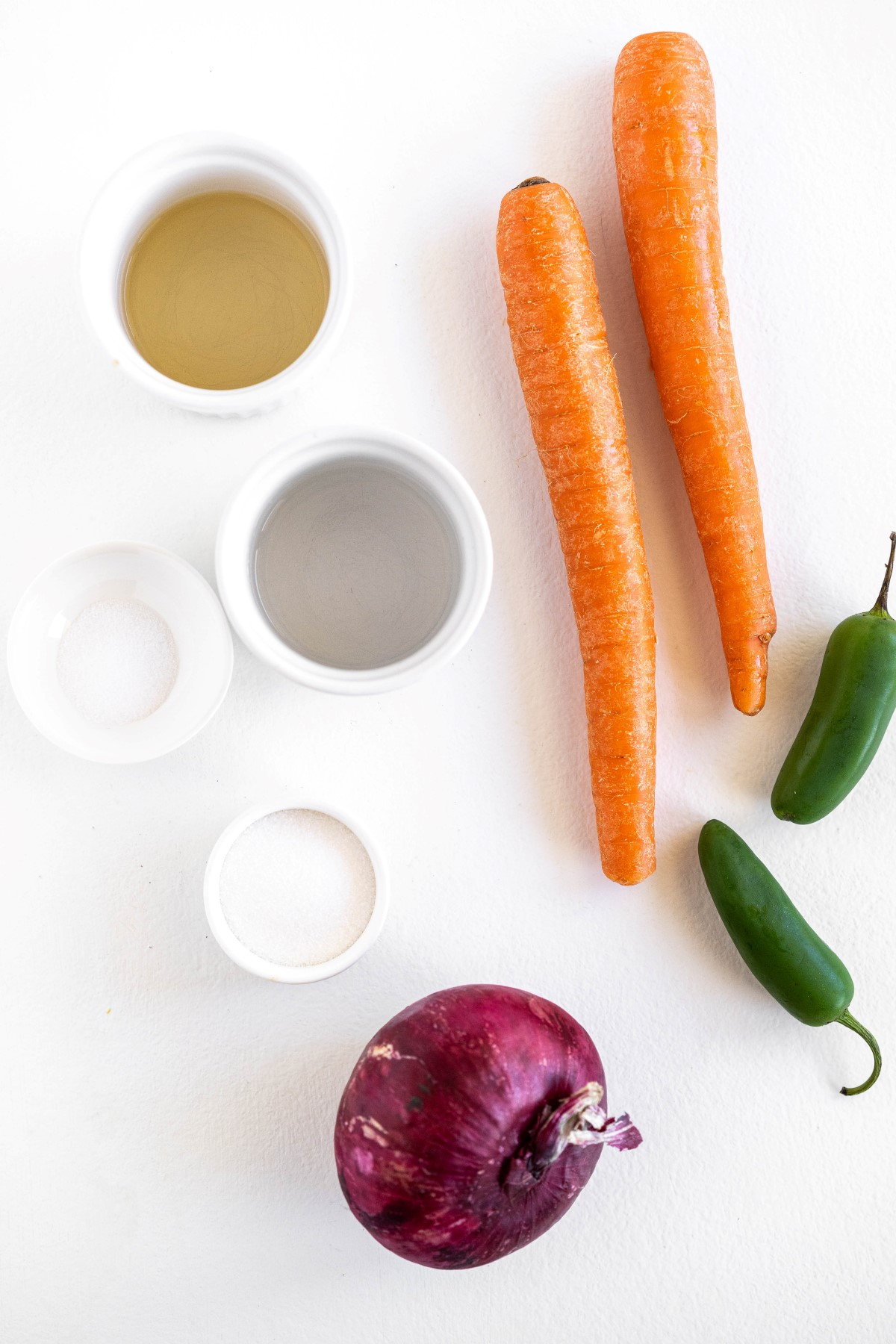 Ingredients used in the quick pickled vegetables including carrots, Red onion and jalapenos